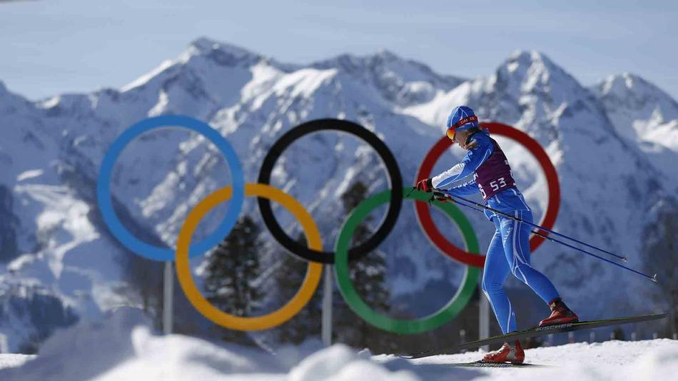 Greece's Panagiota Tsakiri passes by the Olympic rings in the Cross Country stadium prior to the 2014 Winter Olympics, Friday, Feb. 7, 2014, in Krasnaya Polyana, Russia.