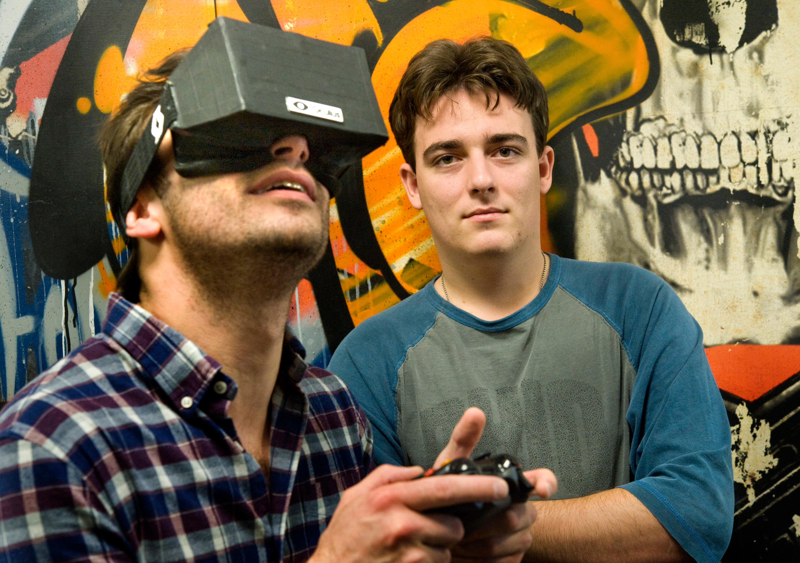 Nov. 14, 2011 - Irvine, California, U.S. - Oculus VR founder Palmer Luckey, 20, right, is the inventor of a virtual reality gaming headset that aims to be the next generation video game console. Oculus, based in Irvine, raised  $2.4 milliion on Kickstarte